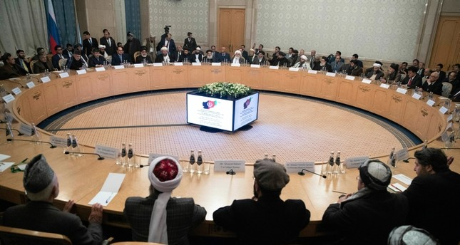 Afghan politicians attend the intra-Afghan talks at the President Hotel in central Moscow (AP Photo)