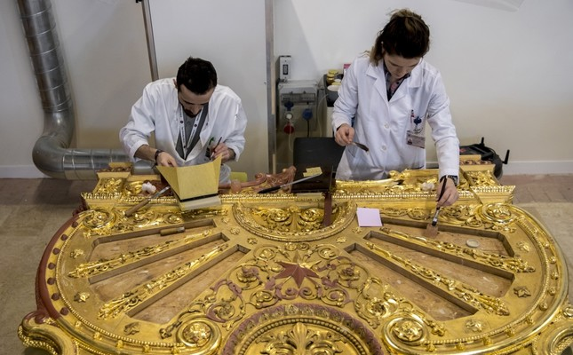 Restorers work on a piece with gold leafs from a bed belonging to Sultan Abdülaziz in the workshop in Istanbul, Feb. 14, 2019.