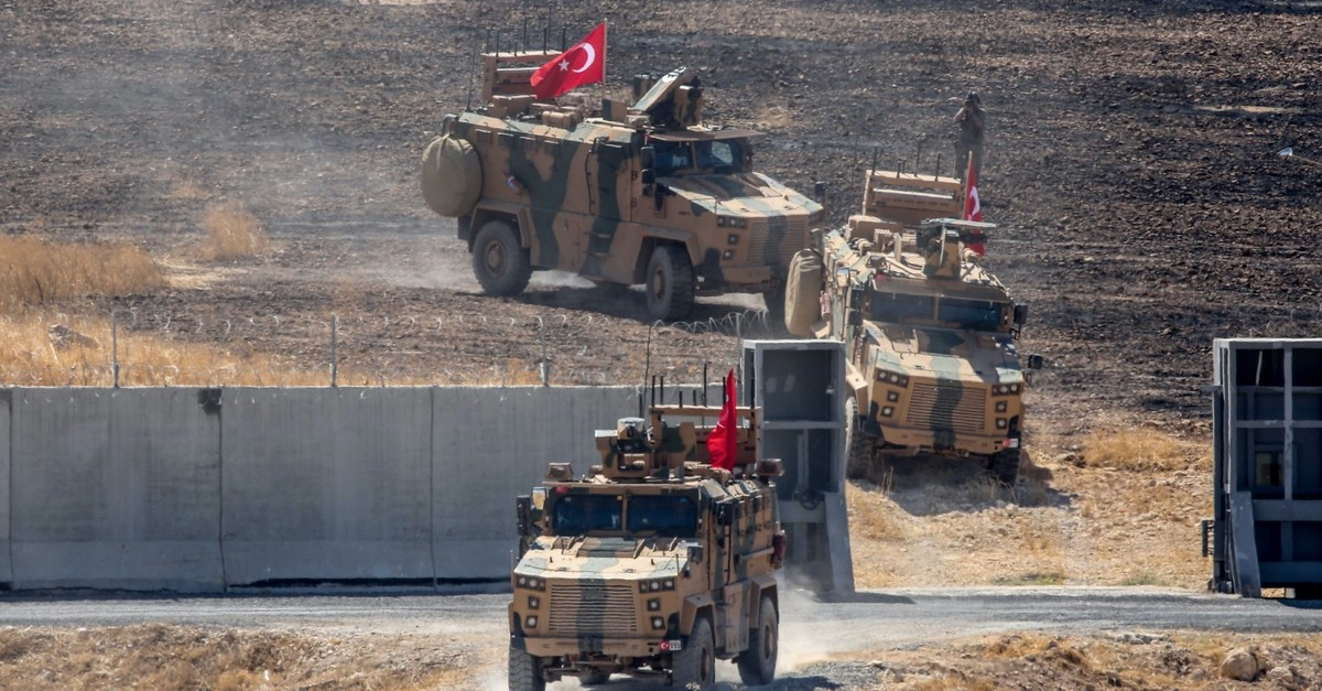 Turkish military vehicles patrol areas in northern Syria for a planned safe zone, Sept. 26, 2019.