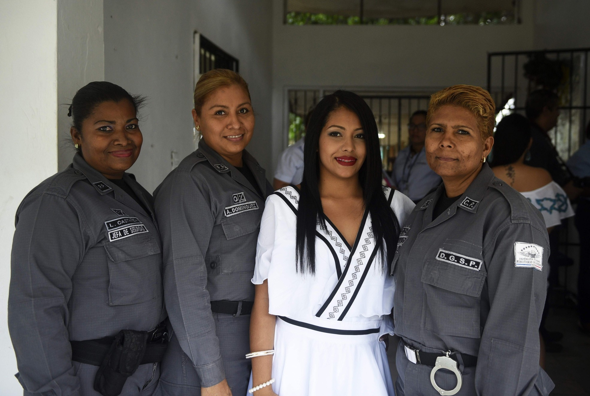 An inmate wearing a creation of the brand u201cIntegraArte,u201d poses next to guards at the u201cCecilia Orillac de Chiariu201d Womenu2019s Rehabilitation Centre in Panama City.