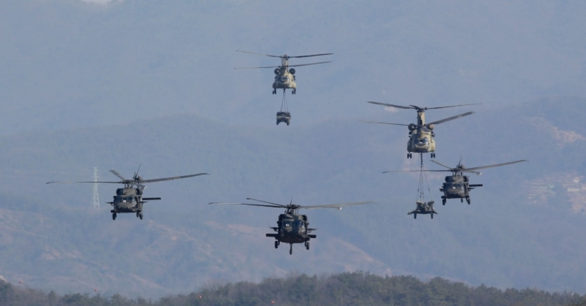 In this March 25, 2015, file photo, U.S. Army helicopters fly during the annual joint military exercise Foal Eagle between South Korea and the U.S. at the Rodriquez Multi-Purpose Range Complex in Pocheon, north of Seoul, South Korea. (AP Photo)