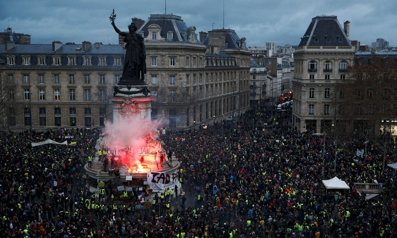 A view of the Place de la Republique as protesters wearing yellow vests gather during a national day of protest by the ,yellow vests, movement in Paris, France, Dec. 8.