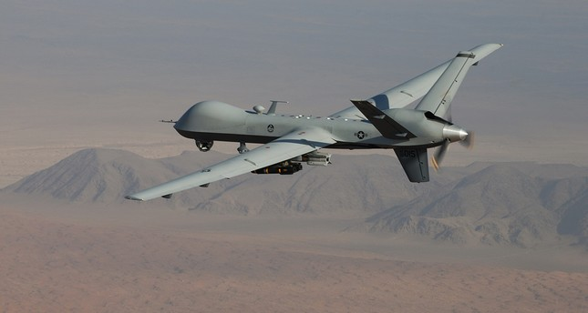 An MQ-9 Reaper, armed with GBU-12 Paveway II laser-guided munitions and AGM-114 Hellfire missiles, flies over southern Afghanistan. (U.S. Air Force Photo)
