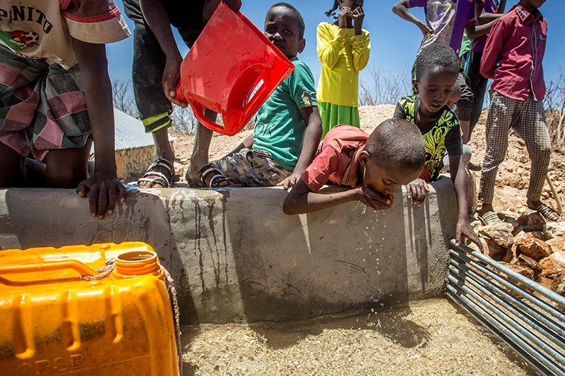 Children drink water delivered by a truck in the drought-stricken Baligubadle village near Hargeisa, the capital city of Somaliland (Reuters Photo)