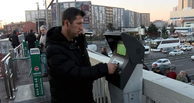 A commuter checking his bus fare card credits at a metrobus station in Cevizlibağ district, Istanbul, Feb. 10, 2020. DHA Photo