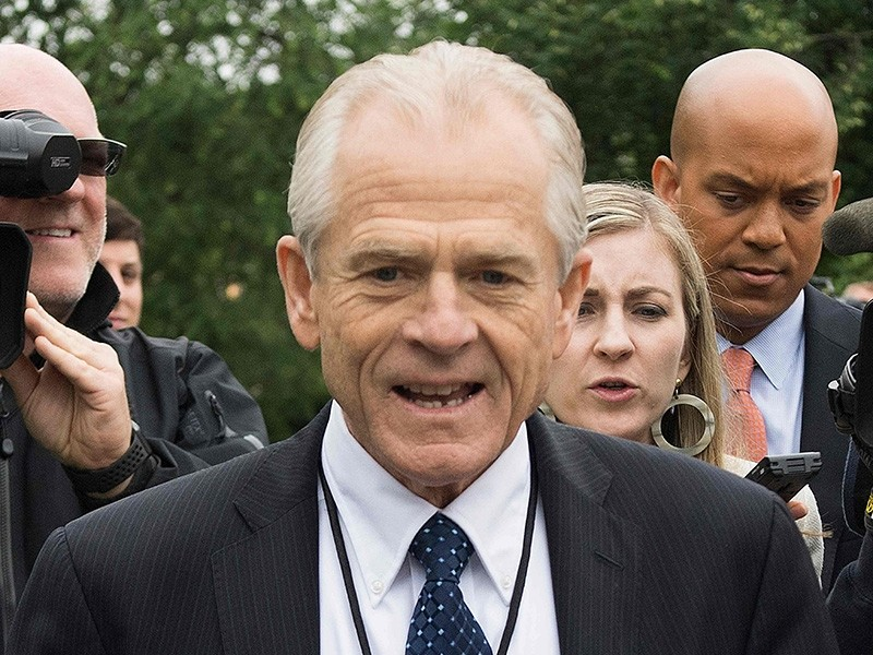 White House Director of Trade Policy Peter Navarro dodges the press after speaking on Fox News at the White House in Washington, DC, on June 4, 2018. (AFP Photo)