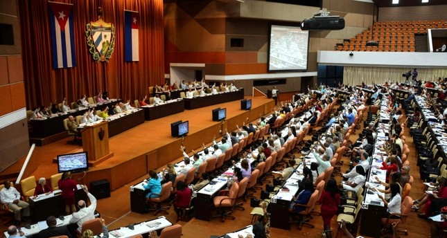 Cuba adopts new constitution, drops communism