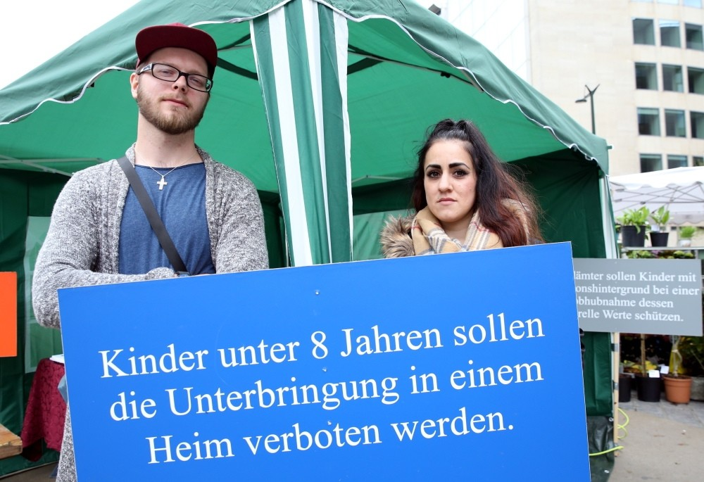 Patrick (L) and Ayu015fe (R) Dahlhoff joined the demonstration in Brussels against Germany. (AA Phoyo)