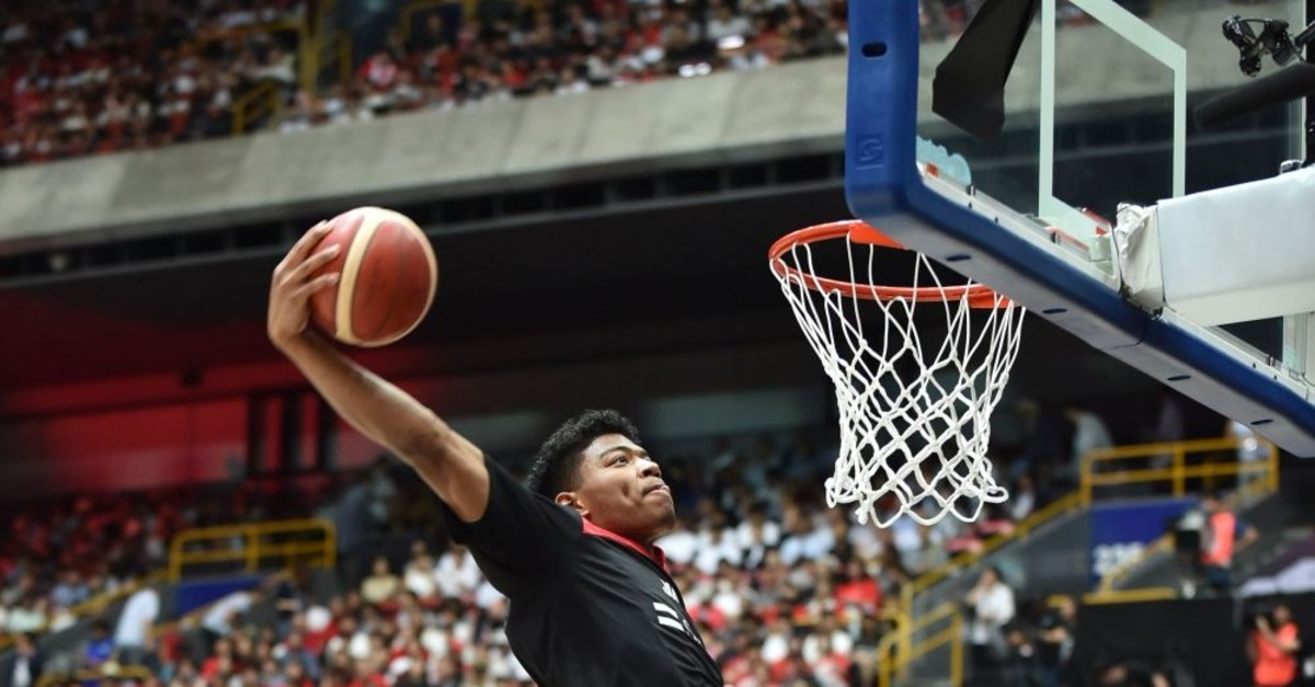 Japanu2019s Rui Hachimura warming up  before a basketball match between  Japan and Germany at Saitama  Super Arena, a venue for the Tokyo 2020 Olympic Games, Aug. 24, 2019.