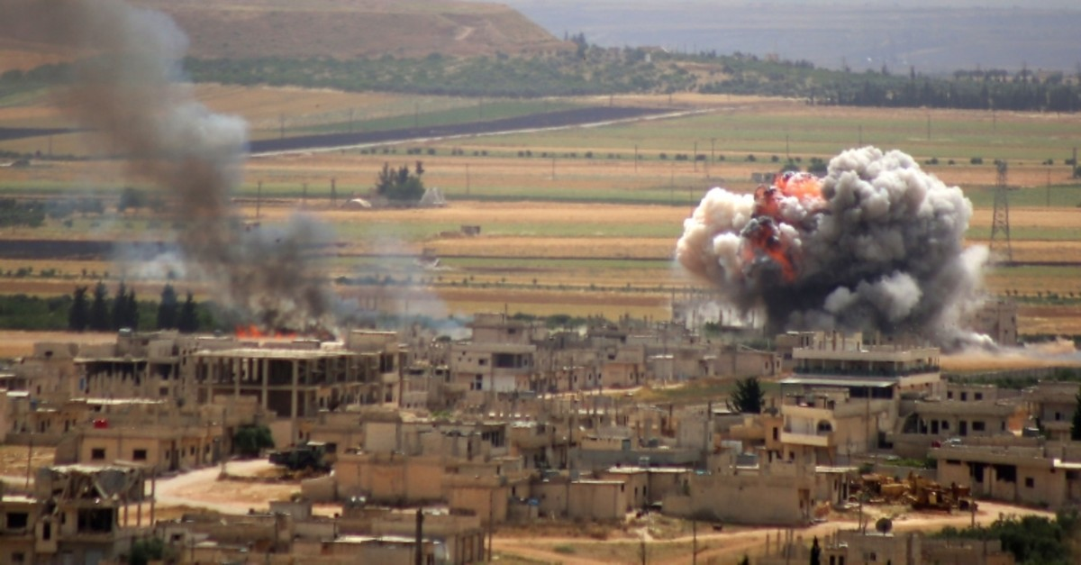 In this file photo taken on June 6, 2019, smoke and fire rise following Syrian regime forces' bombardment on the town of Khan Sheikhun in the southern countryside of the Idlib province. (AFP Photo)