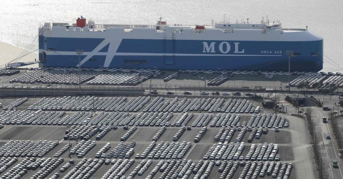 This Feb. 6, 2020, photo shows rows of Hyundai cars parked for shipping in the southeastern port of Ulsan, South Korea. (Yonhap via AFP)