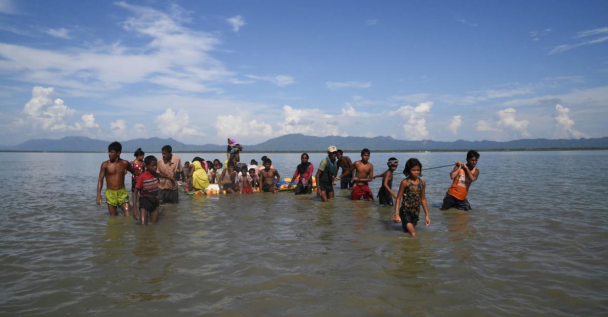 Rohingya Muslim refugees sailing a makeshift raft across the Naf River into Bangladesh at Sabrang, Teknaf district, Nov. 11, 2017.