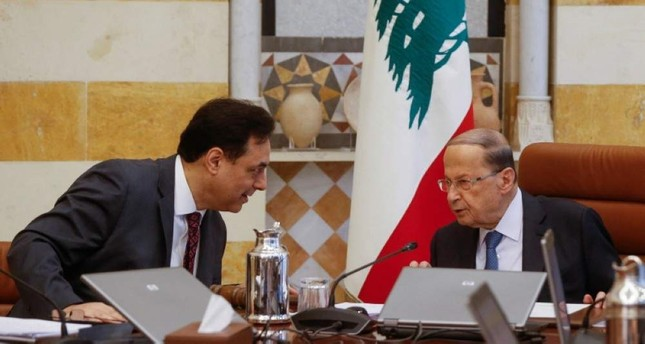 Lebanon's Prime Minister Hassan Diab speaks with Lebanon's President Michel Aoun during a cabinet meeting at the presidential palace in Baabda, Lebanon Feb. 6, 2020. Reuters Photo