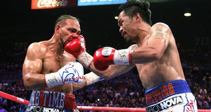 Pacquiao beats Thurman to capture WBA title