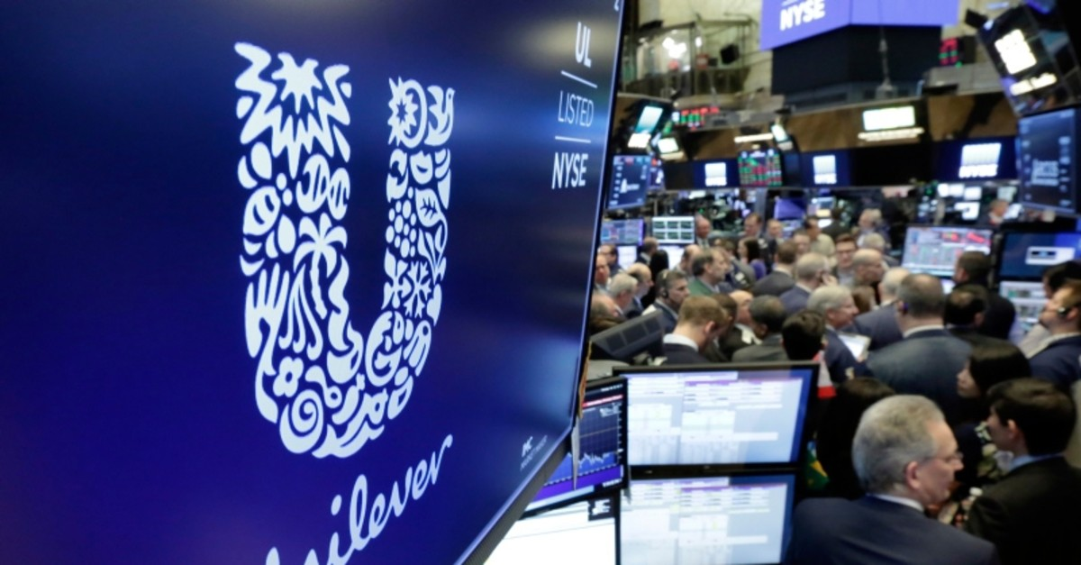 In this Thursday, March 15, 2018 file photo, the logo for Unilever appears above a trading post on the floor of the New York Stock Exchange (AP Photo)