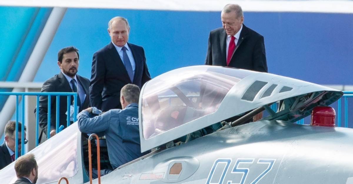 President Recep Tayyip Erdou011fan, right, and Russian President Vladimir Putin examine a Sukhoi Su-57 fighter jet duringthe MAKS 2019 air show in Zhukovsky, outside Moscow, Russia, Aug. 27, 2019. (AP Photo)