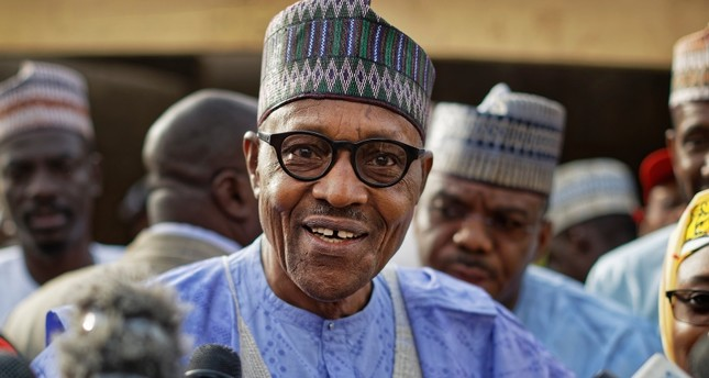 In this Saturday, Feb. 23, 2019 file photo, Nigeria's President Muhammadu Buhari speaks to the media after casting his vote in his hometown of Daura, in northern Nigeria. (AP Photo)