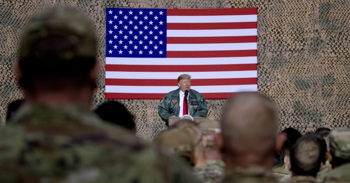 In this Dec. 26, 2018, file photo, President Donald Trump speaks to members of the military at a hangar rally at Ain al-Asad air base, Iraq. Iran struck back at the United States for the killing of a top Iranian general early Wednesday, Jan. 8, 2020
