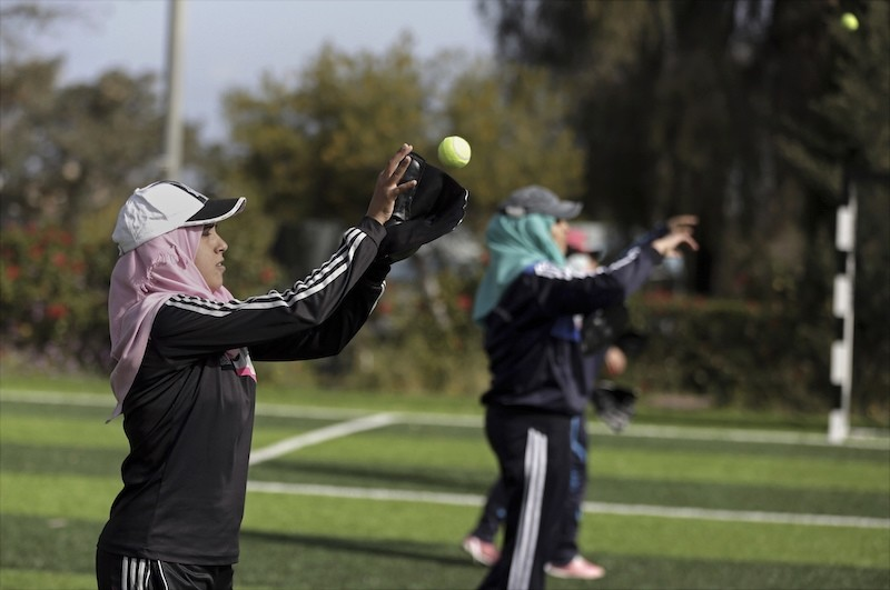 Palestinian women practice with tennis balls while training for an all women's baseball game, on a soccer field in Khan Younis, southern Gaza Strip. (AP Photo)