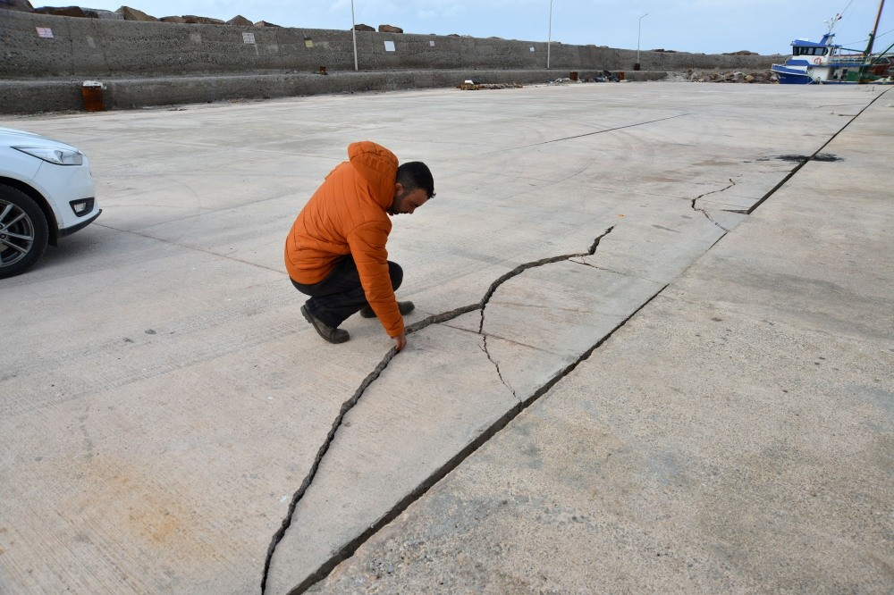 A man shows a crack the earthquake caused at a port in Gu00fclpu0131nar near the town of Ayvacu0131k, the epicenter of yesterdayu2019s tremor.