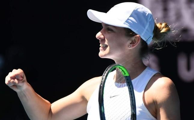 Halep celebrates after beating Kontaveit at the Australian Open quarterfinals in Melbourne, Jan. 29, 2020. AFP Photo