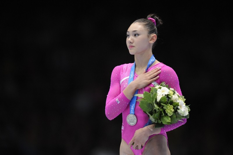 In this file photo taken on October 4, 2013 Silver medalist US gymnast Kyla Ross celebrates on the podium of the all-around final at the 44th Artistic Gymnastics World Championships in Antwerp. (AFP Photo)