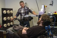 Paralyzed US man feels again through mind-controlled robotic arm