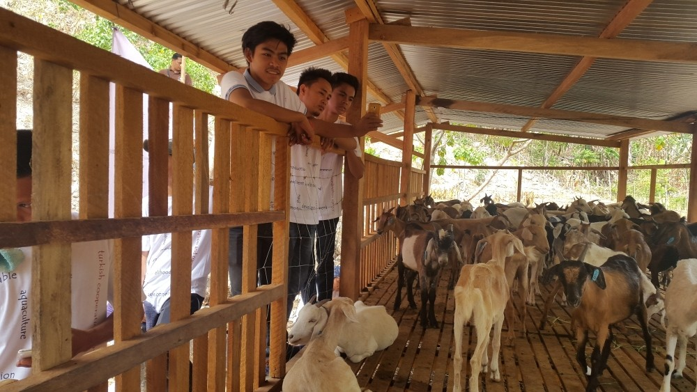 Locals at a pen for goats provided by Tu0130KA in Mindanao. The agency also aims to boost agricultural income in the island.