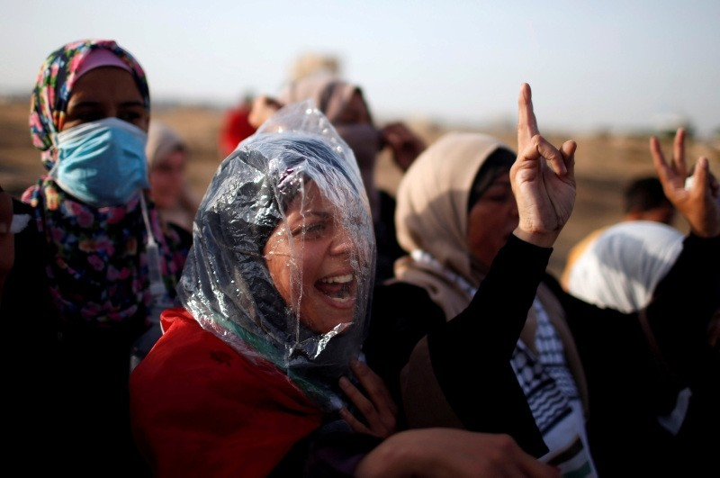 A female demonstrator wearing a plastic bag chants slogans during a protest where Palestinians demand the right to return to their homeland, at the Gaza Strip, east of Gaza City, May 18.