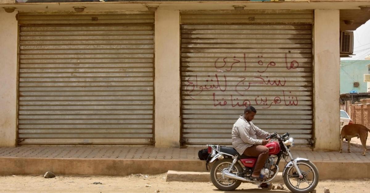 A Sudanese man sits on a motorbike, Khartoum, June 9, 2019.