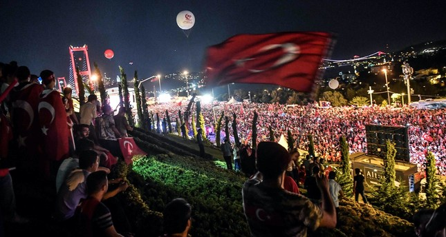 People gather at the 15 July Martyrs' Bridge to attend the anniversary ceremony of the July 15, 2016 coup attempt, Istanbul, July 15, 2018.