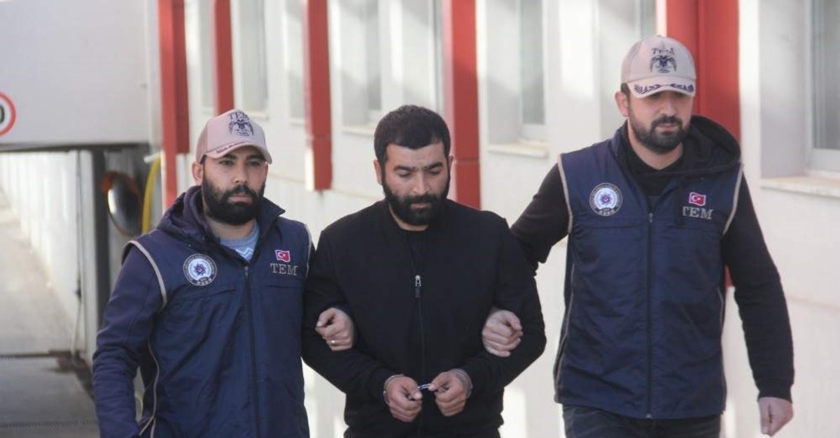 Officers escort the suspect to a local police station in Adana, Jan. 11, 2020 (IHA Photo)