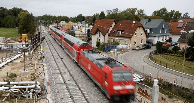 A train rides a part of the re-opened railway track in Rastatt, Germany, 02 October 2017 (EPA Photo)