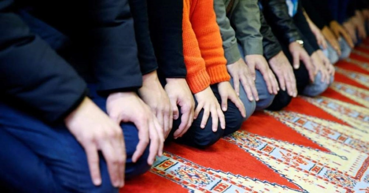 Muslims pray during Friday prayers at a Turkish mosque in Cologne. (Reuters Photo)