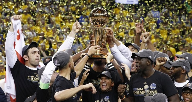 Golden State Warriors celebrate with the Larry O'Brien NBA Championship Trophy after winning the NBA Finals against the Cleveland Cavaliers in Game 5 of the NBA Finals at Oracle Arena in Oakland.