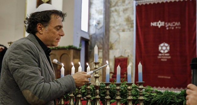A Jewish man lights a Hanukkah menorah in Istanbul's Neve Şalom Synagogue, Dec. 21, 2017.