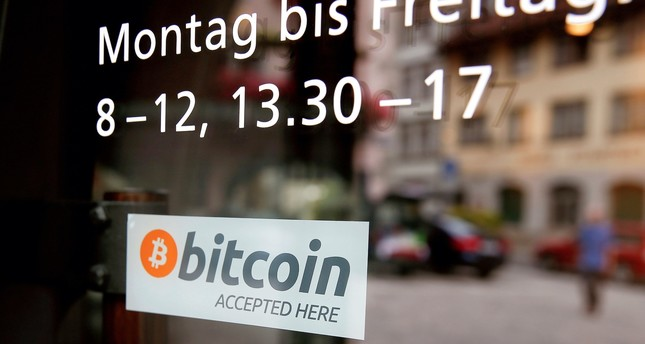 """A sticker that reads """"Bitcoin accepted here"""" is displayed at the entrance of the Stadthaus town hall  in Zug, Switzerland, August 30, 2016."""