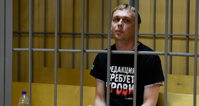 Ivan Golunov, a journalist who worked for the independent website Meduza, sits in a cage in a court room in Moscow, Russia, Saturday, June 8, 2019. (AP Photo)