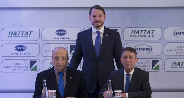 Energy Minister Berat Albayrak C at the signing ceremony of the protocol on the Zetes-Hattat Transformation into Domestic Coal. Hattat Holding Chair Mehmet Hattat L and Eren Holding Chair Ahmet Eren R signed the protocol.