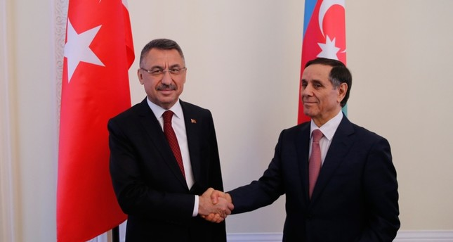 Turkish Vice President Fuat Oktay (L) and Azerbaijani Prime Minister Novruz Memmedovi shake hands at eighth meeting of the Turkey-Azerbaijan Joint Economic Commission (KEK) in Baku, Azerbaijan, on Sept. 16, 2019. (AA Photo)