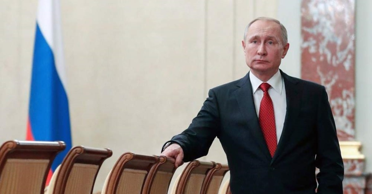 Russian President Vladimir Putin stands prior to a Cabinet meeting, Moscow, Jan. 15, 2020. (AP Photo)