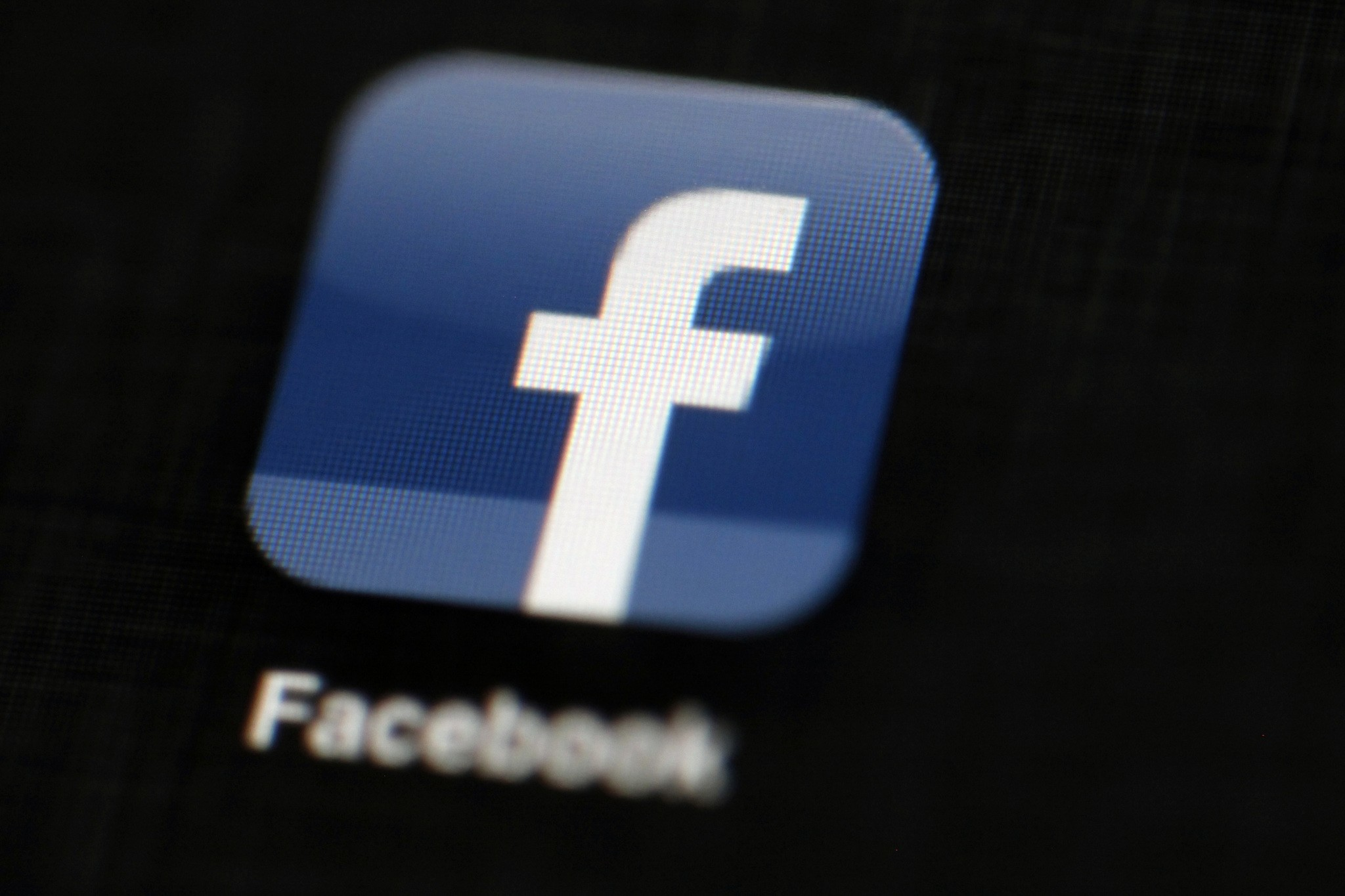 In this May 16, 2012, file photo, the Facebook logo is displayed on an iPad in Philadelphia. (AP Photo)
