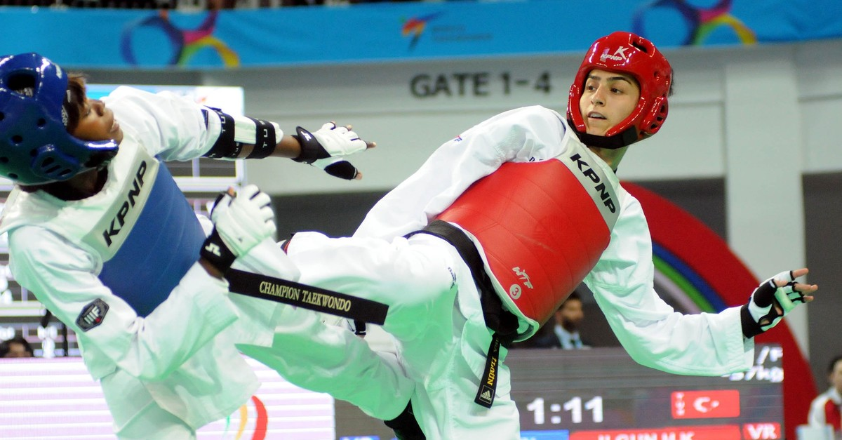 Hatice Ku00fcbra u0130lgu00fcn (right) fights Mary Muriu of Kenya during the 2017 World Taekwondo Championship in Muju, South Korea, June 30, 2017.