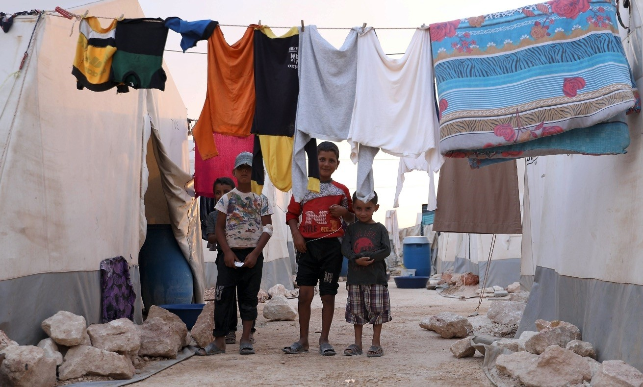 Displaced Syrian children pose for a photograph in the camp u201cHopeu201d in Kafaldin on the Syrian-Turkish border, Sept. 13.