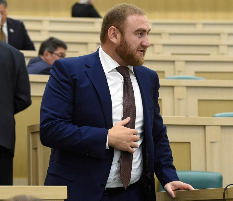 In this photo taken on Wednesday, Sept. 28, 2016, Rauf Arashukov, who represents the Karachaevo-Cherkessiya region in the North Caucasus, stands at the Federation Council, in Moscow, Russia. (Dmitry Dukhanin/Kommersant Photo via AP)
