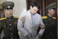 As coroner examines death of US student released by North Korea, Trump calls incident 'a total disgrace'