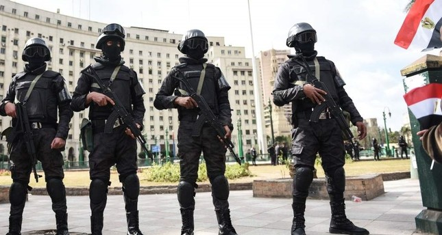 Members of the Egyptian police special forces stand guard on Tahrir Square, Cairo, Jan. 25, 2016. AFP Photo