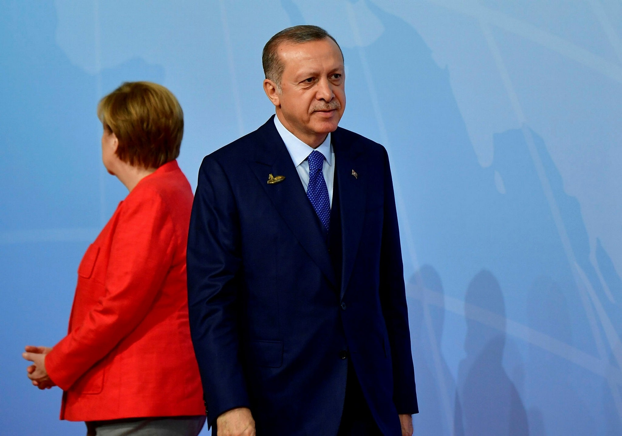 German Chancellor Angela Merkel (L) stands by President Recep Tayyip Erdou011fan as he arrives to attend the G20 Summit in Hamburg, Germany, July 7.