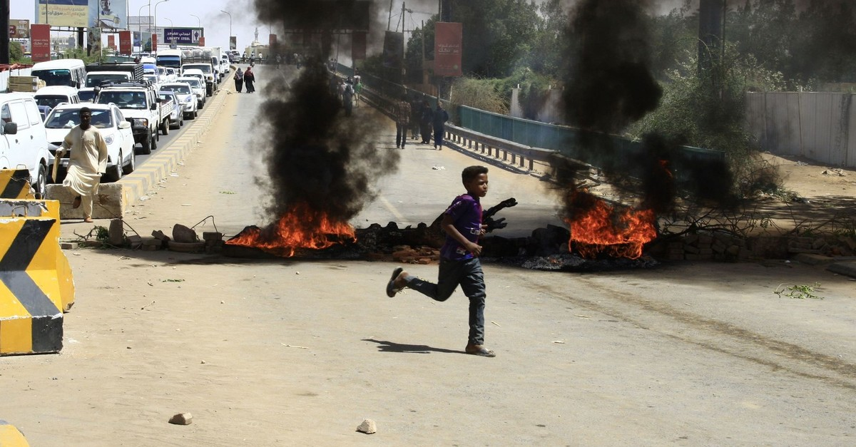 Tires are pictured ablaze during a demonstration in the capital Khartoum, Sudan, May 13, 2019.