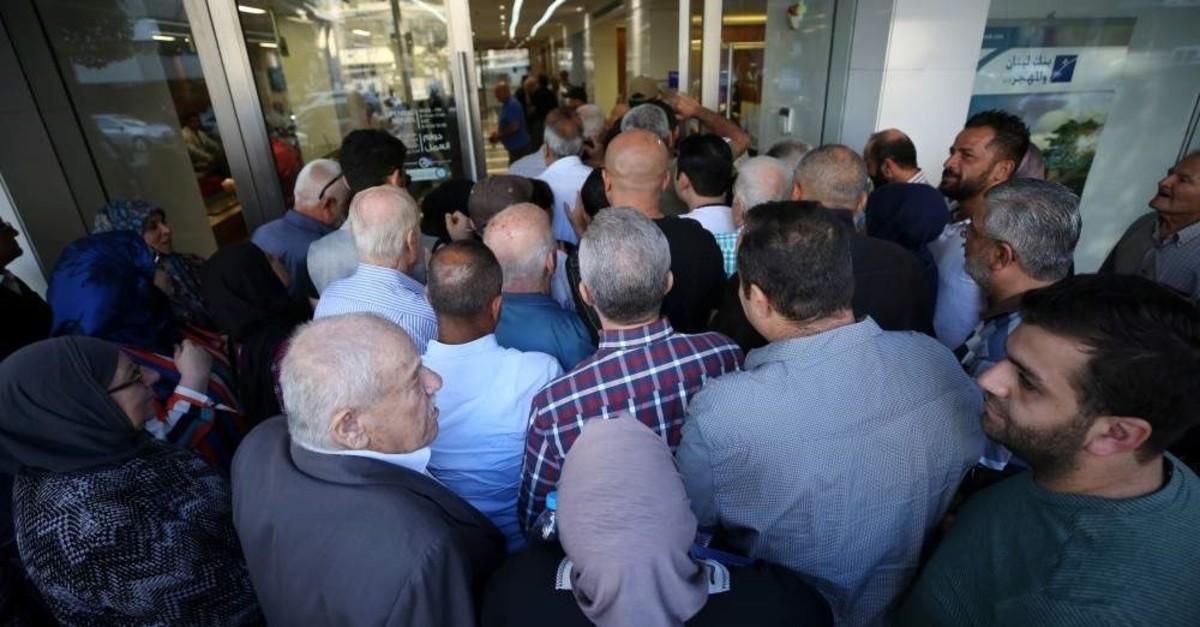 People queue outside a bank in Sidon, Lebanon, Nov. 1, 2019. (Reuters Photo)